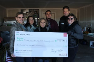 Pictured (left to right) is Greater Albuquerque Habitat for Humanity Board President Lori Valdez, Ruby Garcia (Victor Hoak's mother), Greater Albuquerque Habitat for Humanity Executive Director Joan Costello, Habitat Homeowner Victor Hoak, Wells Fargo Home Mortgage Manager and Greater Albuquerque Habitat for Humanity board member Jeff Payne, and Wells Fargo Community Development Vice President Pat Nie.